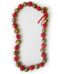 red and gold kukui nut lei